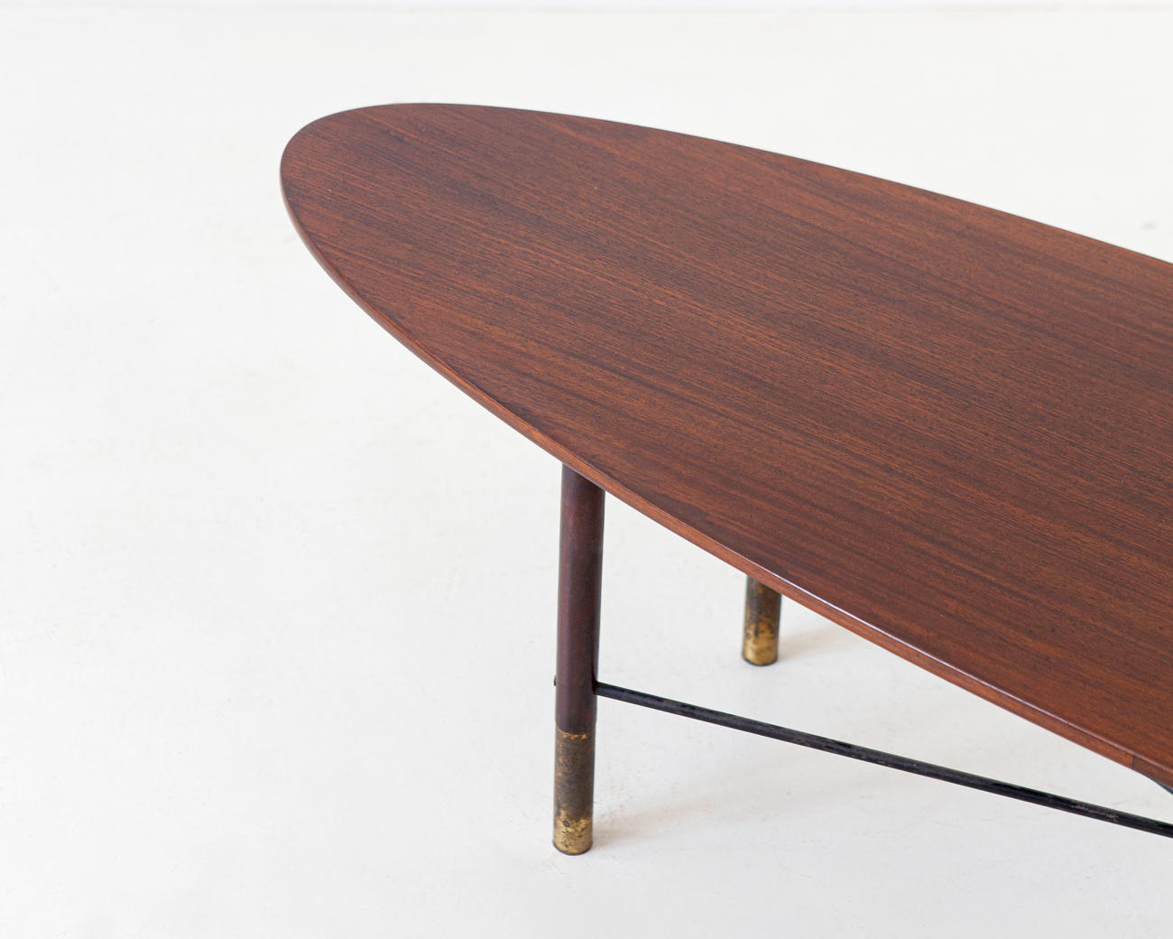 1950s-dark-teak-and-brass-elliptical-coffee-table-1-t90