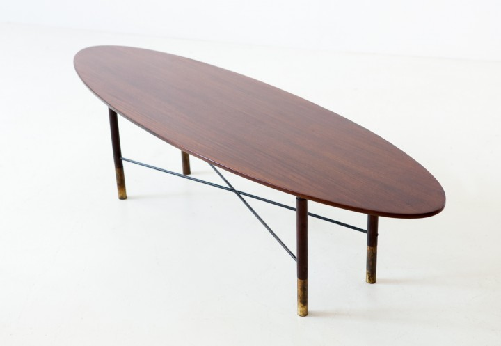 1950s dark teak and brass elliptical coffee table T90