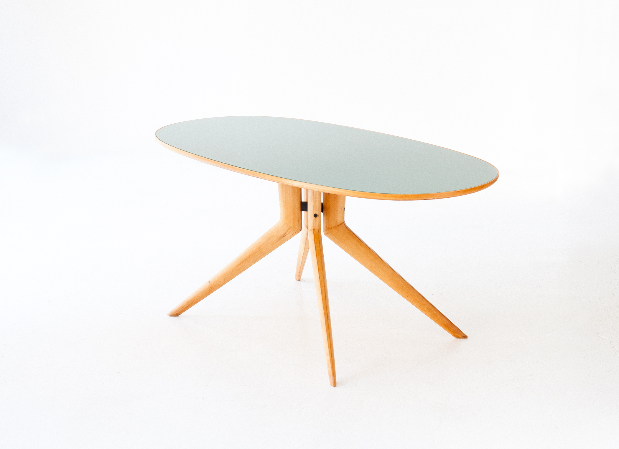 Elliptical-beech-light-green-dining-table-1